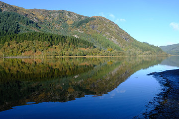 Reflections of autmumn colours in the waters of Loch Lubnaig in the Scottish Highlands