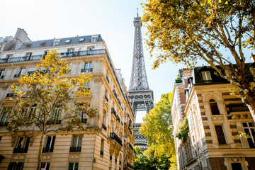 Beautiful street view with old residential buildings and Eiffel tower during the daylight in Paris