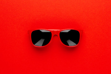 studio shot of red sunglasses. summer is coming concept