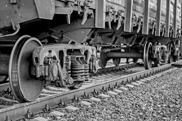 Freight train, iron wheels train close-up, black and white color