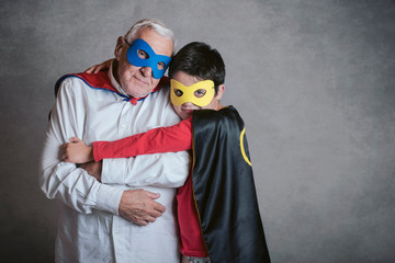 Grandfather With Grandson dressed as a superhero