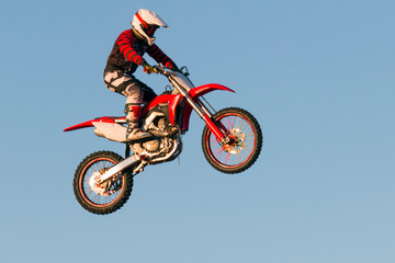 Freestyle motocross biker performs the jump at fmx competitions