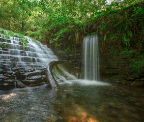 Picturesque waterfalls in ancient dams