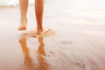 Children walking on beach.