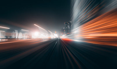 View from first railway carriage. Speed motion blur metro abstract background at night