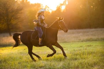 Girl equestrian rider riding a beautiful horse