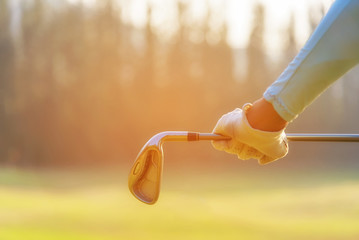 Close up hand golfer.  Women player golf holding clubs for warm up and relax body before play game, copy space.  Lifestyle Concept