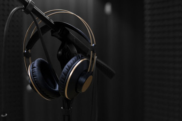 microphone and headphones on a black background