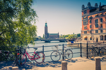 Bike near bridge railing and Stockholm City Hall (Stadshuset), Sweden