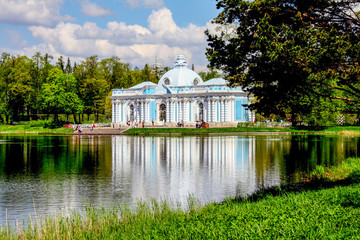Blue pavilion on the shore of A large pond