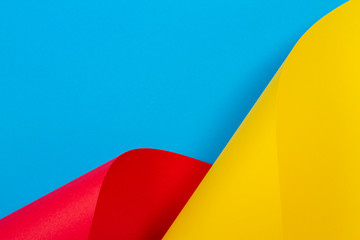 Abstract colorful background. Yellow red blue color paper in geometric shapes