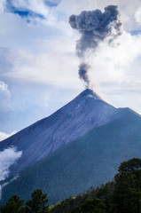 Clouds and ash mix together as Volcano Fuego erupts by daylight. Natural background.