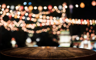 Selective Empty wooden table in front of abstract blurred festive light background with light spots and bokeh for product montage display of product