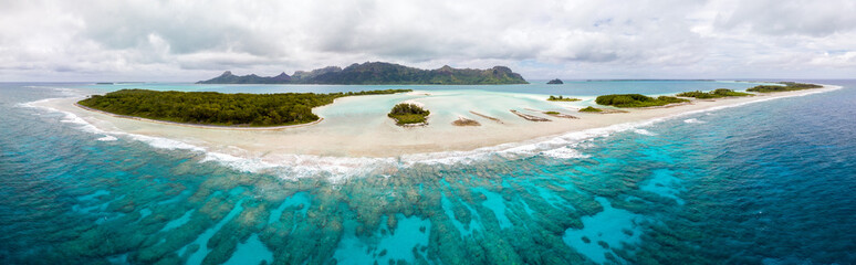 Aerial view of Raivavae island with beaches, coral reef and motu in azure turquoise blue lagoon. Tubuai Islands (Austral ), French Polynesia, Oceania