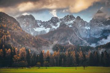 Autumn landscape under big wild Rocky mountains. Julian Alps, Slovenia