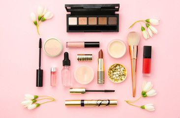 Professional decorative cosmetics, make-up tools and accessory on pink background. Beauty, fashion and shopping concept. flat lay composition, top view. Mockup for beauty blog