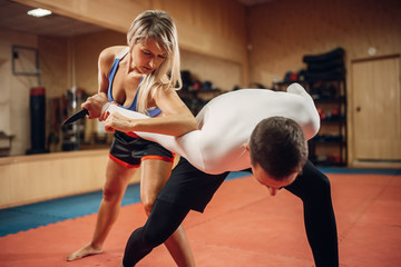 Woman makes elbow kick, self-defense workout