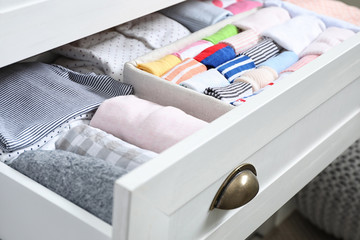Wardrobe drawer with many child socks, closeup