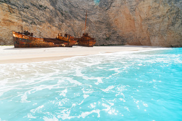 Navagio Shipwreak beach with rusty ship and clear blue water of Zakinthos island, Greece