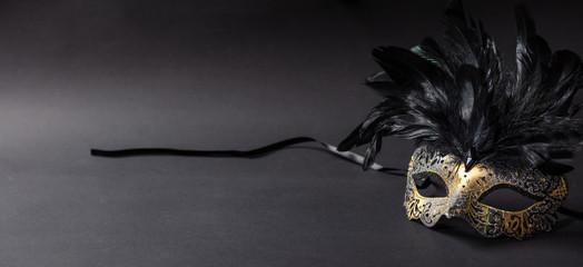 Carnival mask on black background, copy space
