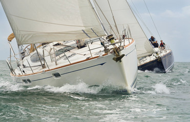 Sail Boats or Yachts Sailing on A Beautiful Sunny Day