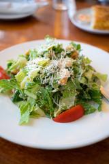 Fresh healthy  Caesar salad on white plate