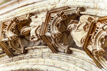 Brussels, Kingdom of Belgium. The exterior of the church is decorated.  Graceful facade and richly carved doors.