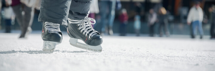 People ice skating on ice rink