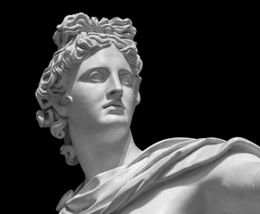 Portrait of a plaster statue of Apollo isolated on black