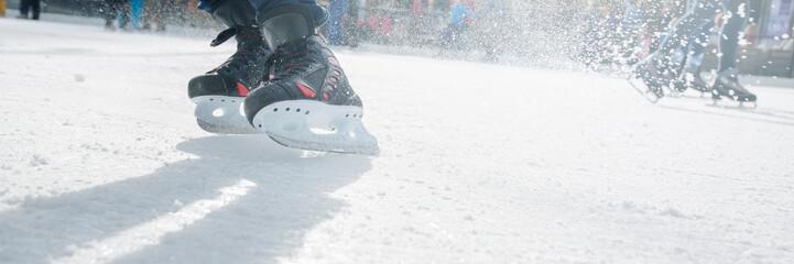 People ice skating on ice rink