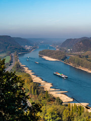 Drought in Germany, low water of the Rhine river in andernach near koblenz influending water transport freight ships