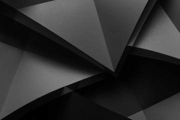 Composition with gray paper folded in geometric shapes