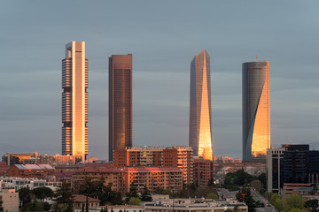 Madrid Four Towers financial district skyline during sunrise in Madrid, Spain.