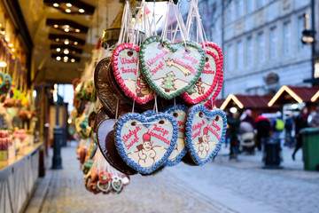 "Gingerbread Hearts at Polish Christmas Market. Wroclaw xmas market in Poland.On traditional ginger bread cookies written ""Marry Christmas"" in Polish"