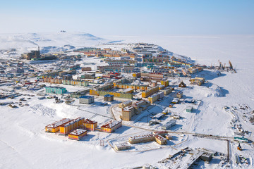 Winter landscape with the northern city of Anadyr. The administrative center of Chukotka and the most eastern city of Russia. Aerial photography of a small arctic city with colorful buildings.