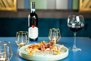 Fine dining design in restaurant with good red wine. Tasty gastronomy