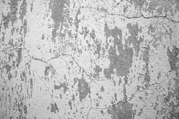 Texture of old cracked wall. Grey color.