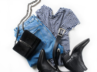 Set of women's outfit  - jeans, western boots, bag, belt and striped pullover oversize
