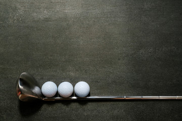 golf ball and golf club on black background