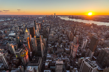 Cityscape of Manhattan, New York at Sunset. United States of America. Aerial View. Wide Shot