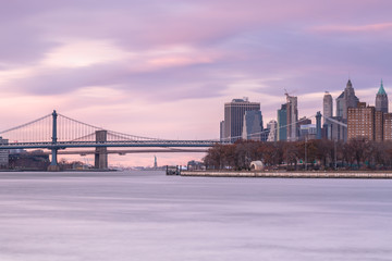Manhattan and Brooklyn bridge view from east river long exposure