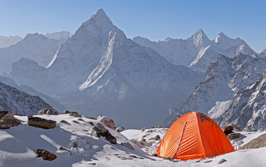 Tent camp at sunrise on the background of Ama Dablam peak (6814 m) in Nepal, Himalayas.