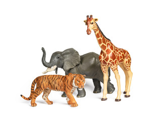 Pastic wild african animal toys isolated on white. Tiger, Elephant and giraffe. Children animal characters for playing zoo game