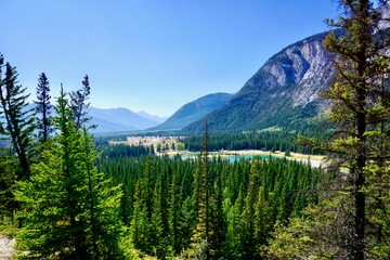 Elevated view of Trans Canada Highway leading past Cascade Ponds into Banff National Park