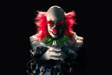 Scary clown on a dark background
