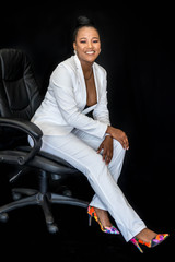 African business woman in white suit
