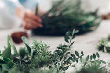 Woman Making A Christmas Wreath