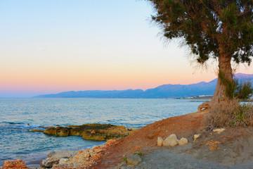 Hersonissos wild beach sunset Crete island Greece