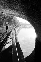 Cyclist and seine river quay in Paris