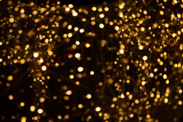 Gold yellow light abstract bokeh on black background